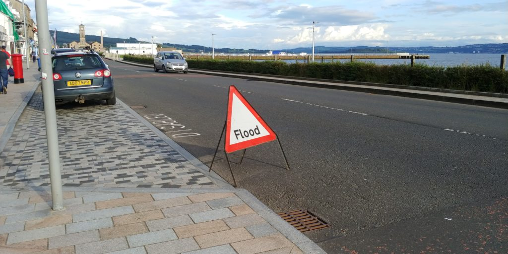 A flood warning sign on West Clyde Street