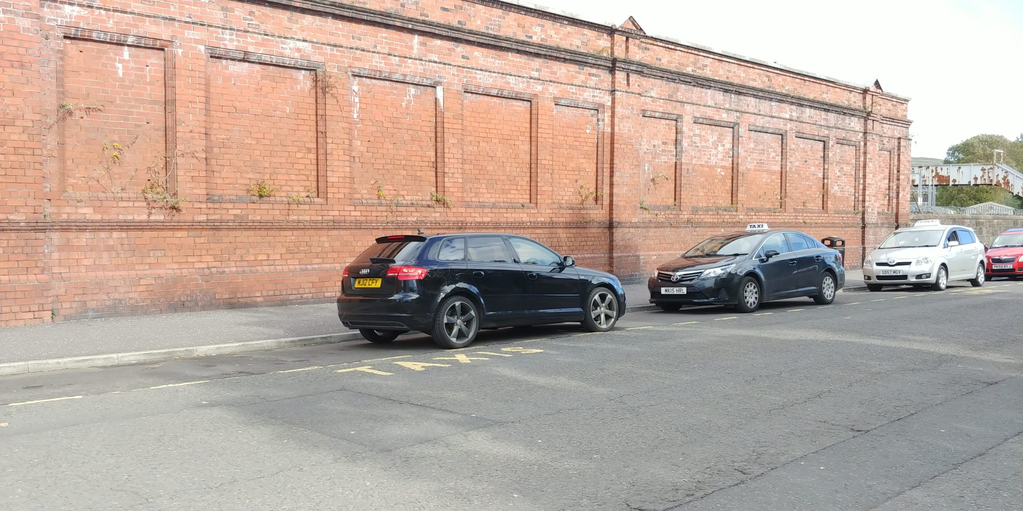 An entitled driver of a black Audi parks head on into the station rank